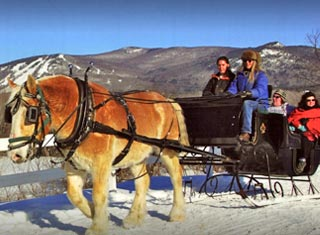 Victorian horse drawn sleigh ride at Farm by the River Stables in North Conway NH